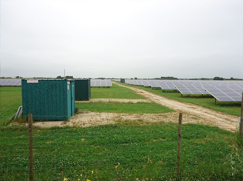 The picture shows the entrance to the PV farm Marchington with CCTV and storage container.